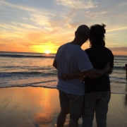 Couple on a beach watching the sunset in Guanacaste Costa Rica